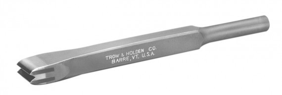 A carbide double blade chisel for creating parallel lines on stone surfaces