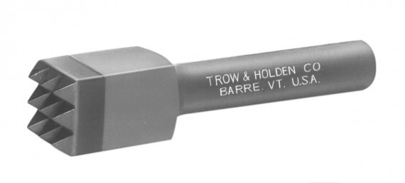 A carbide nine point bushing chisel used for moderate material removal