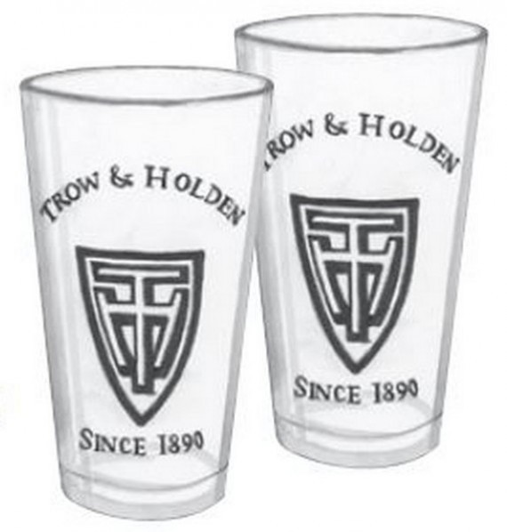 Two tall drinking glasses with the trow and holden logo
