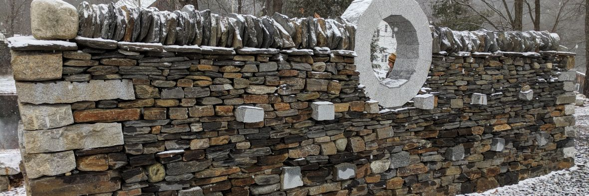 Elaborate stone wall made up of different colored stones