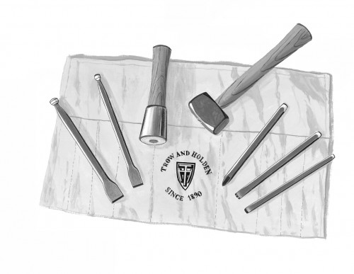 Hard stone hand carving set laid out attractively with hammers chisels and other stone shaping tools