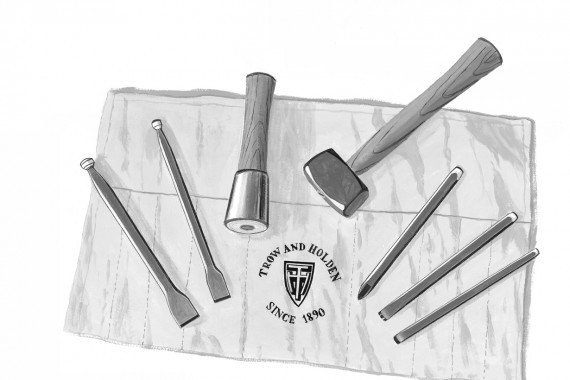 Five carbide tipped chisels and points and two stone hammers used for carving granite marble or limesone