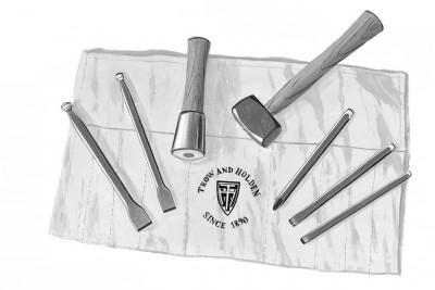 A tool set used for masonry projects including chisels stone hammers and points