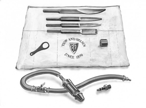 A pneumatic mortar removal set consisting of chisels and pneumatic parts
