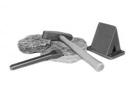 A set of masonry thin stone tools including a hammer chisel and wedge used for trimming thin stone