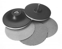 A set of black and gray sharpening pads and wheels used to maintain carbide masonry hand tools