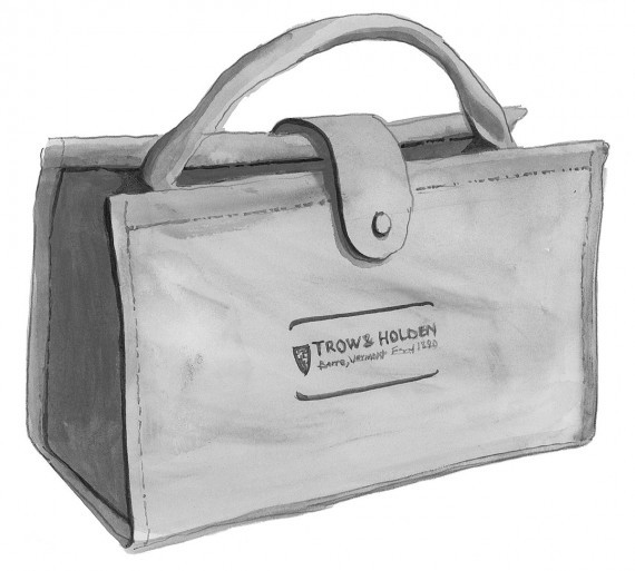 A closed leather tool bag with the trow and holden logo printed on the side