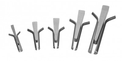 A set of splitting wedges shims and drills used for shaping stone