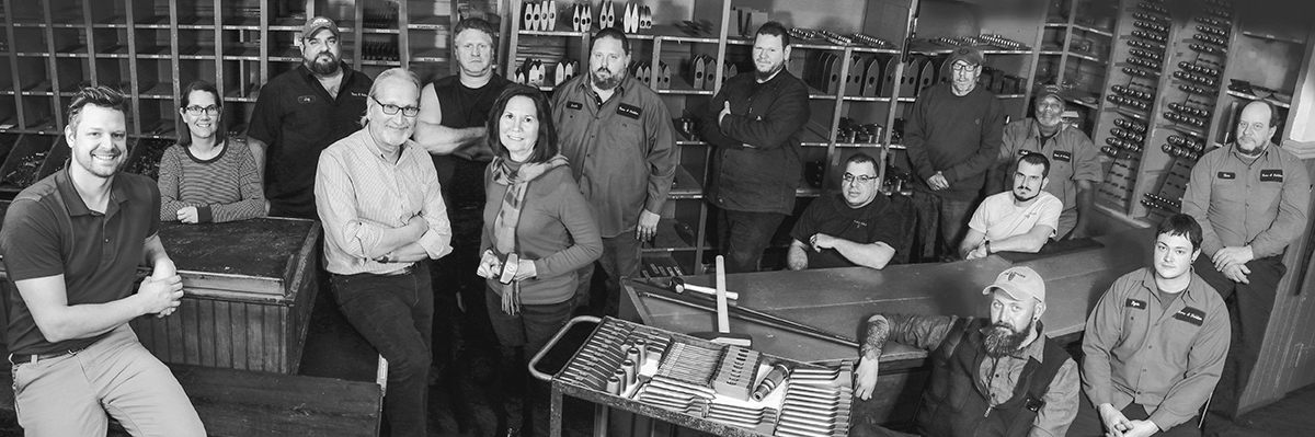 A group photo of our staff in black and white